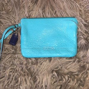 Teal pebbled leather Coach wristlet